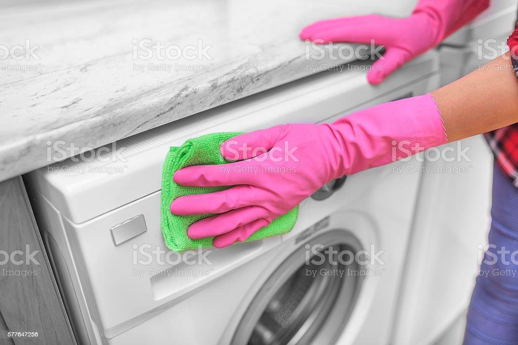 Female hand wash washing machine. stock photo