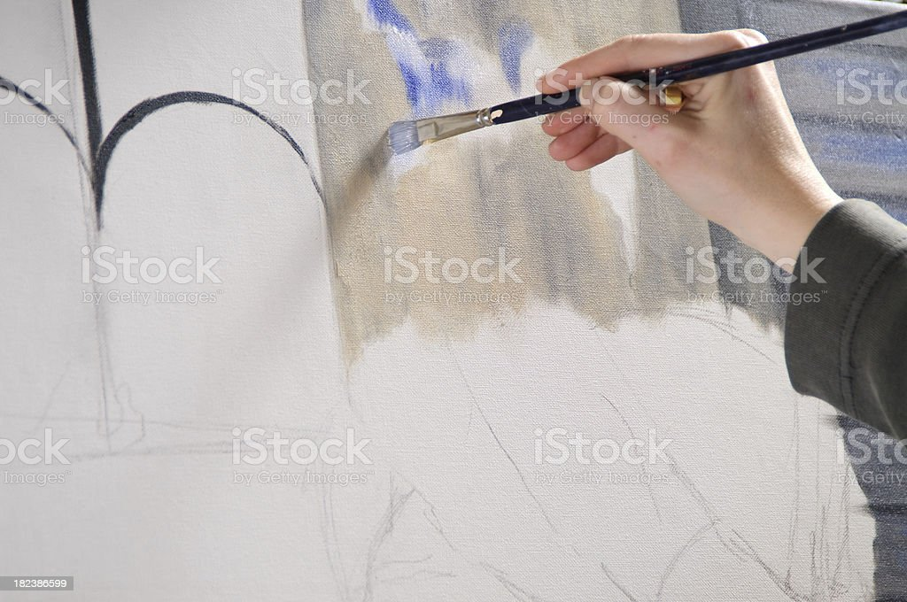Female Hand while Painting royalty-free stock photo