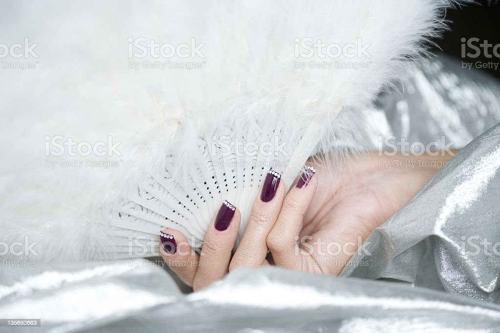 female hand with a fan stock photo