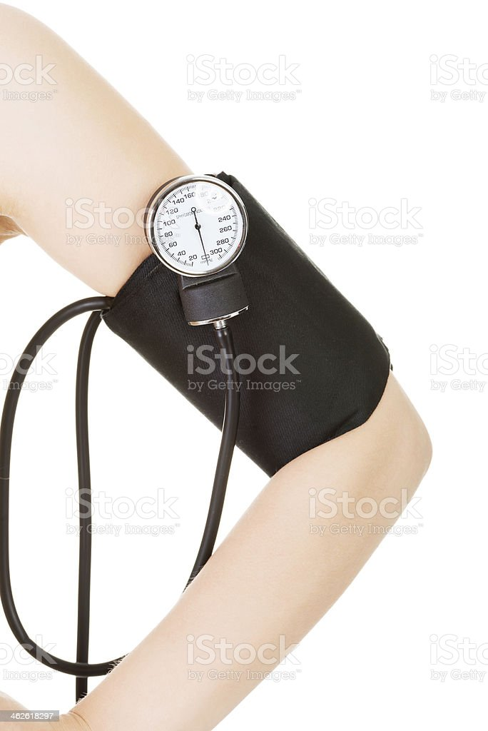 Female hand with blood-pressure meter royalty-free stock photo
