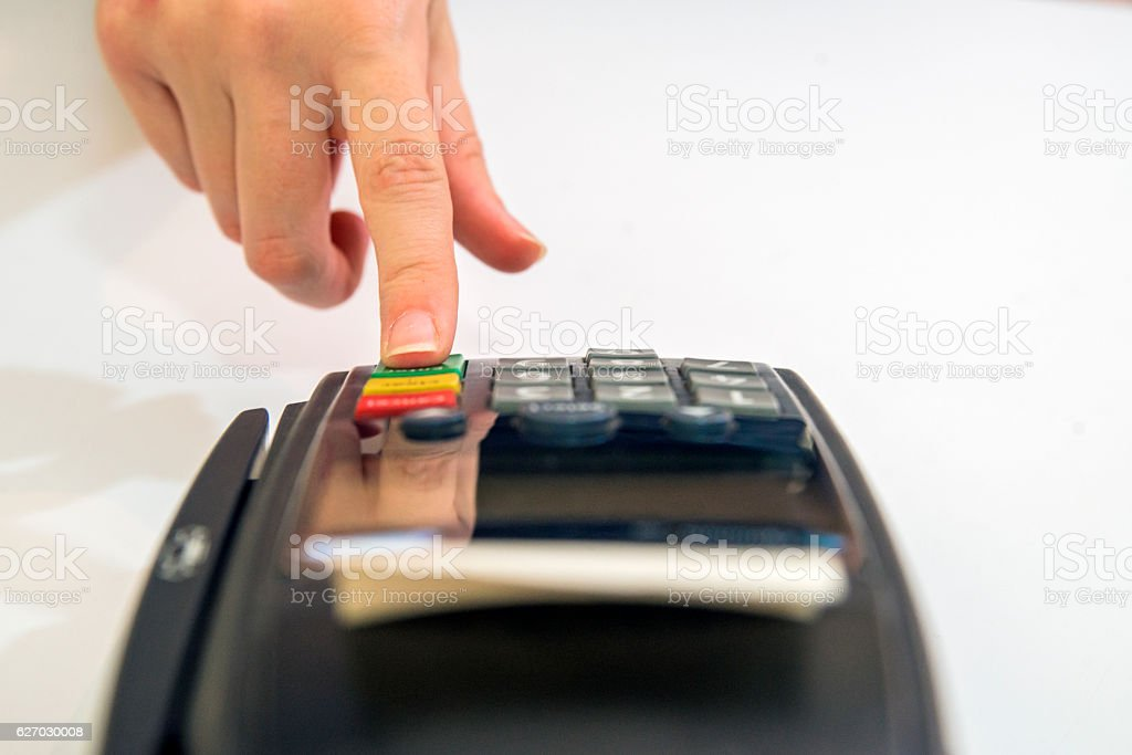 Female hand with credit card and bank terminal stock photo