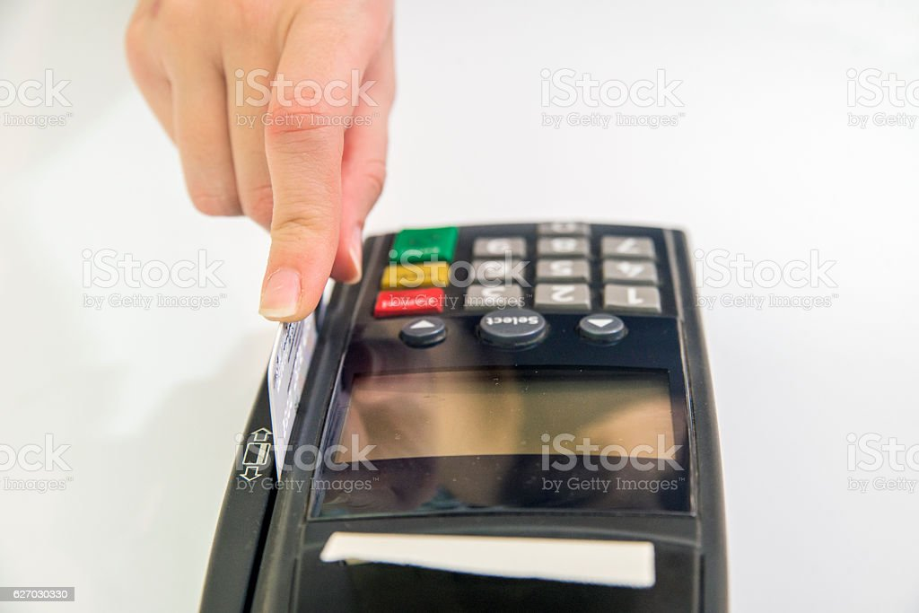 Female hand with credit card and bank terminal, stock photo