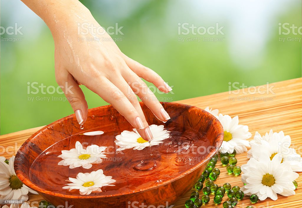 Female Hand with Drops of Water and Wooden Bowl royalty-free stock photo