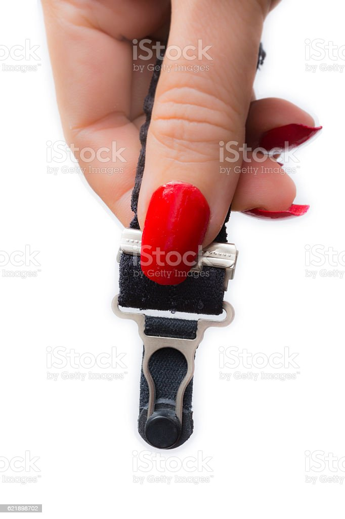 Female hand with  Garter clip stock photo