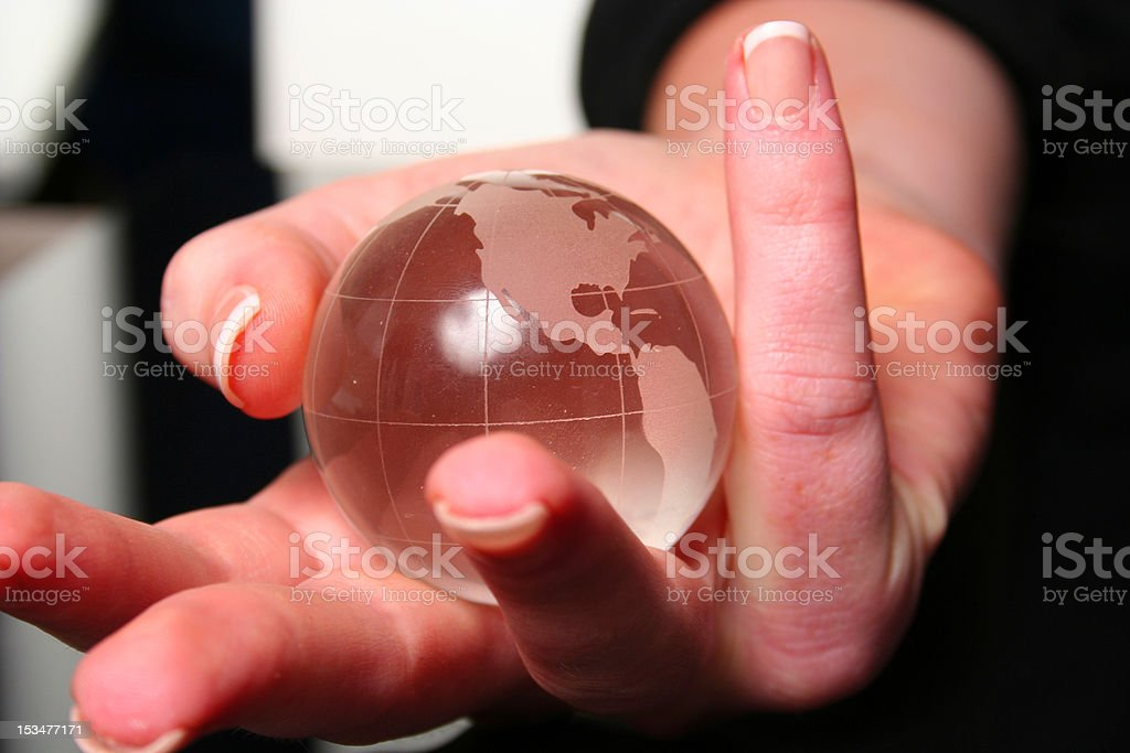 Female hand with globe showing the american continent stock photo