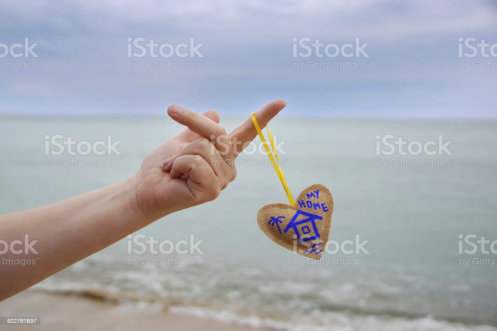 Female Hand With Home Drawning on Heart stock photo
