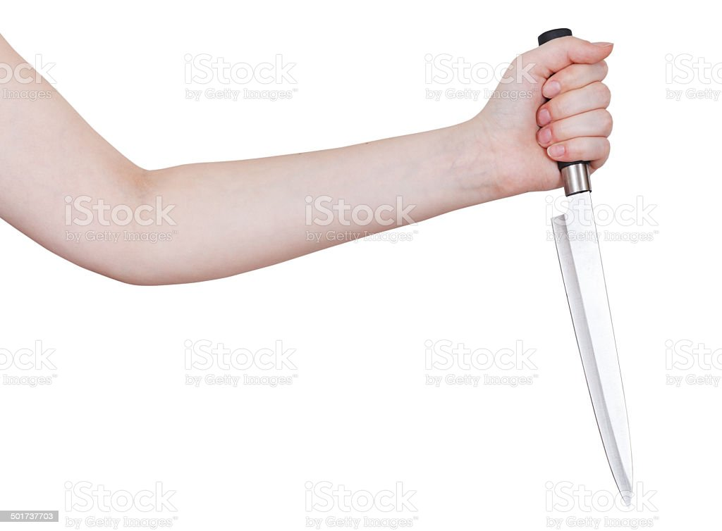 female hand with large kitchen knife stock photo