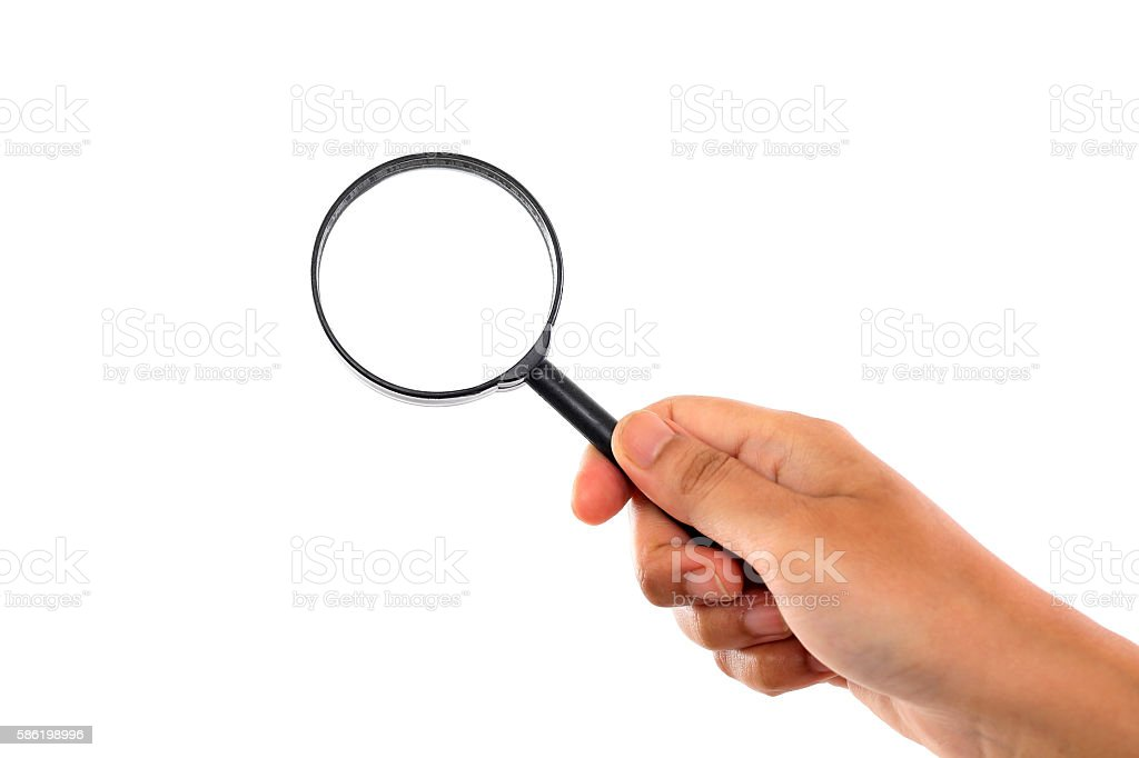 Female hand with magnifying glass against white stock photo