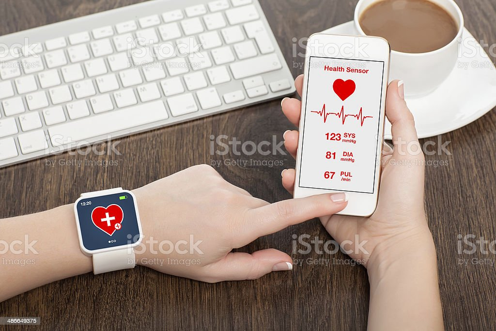 Female hand with mobile health app sensor stock photo