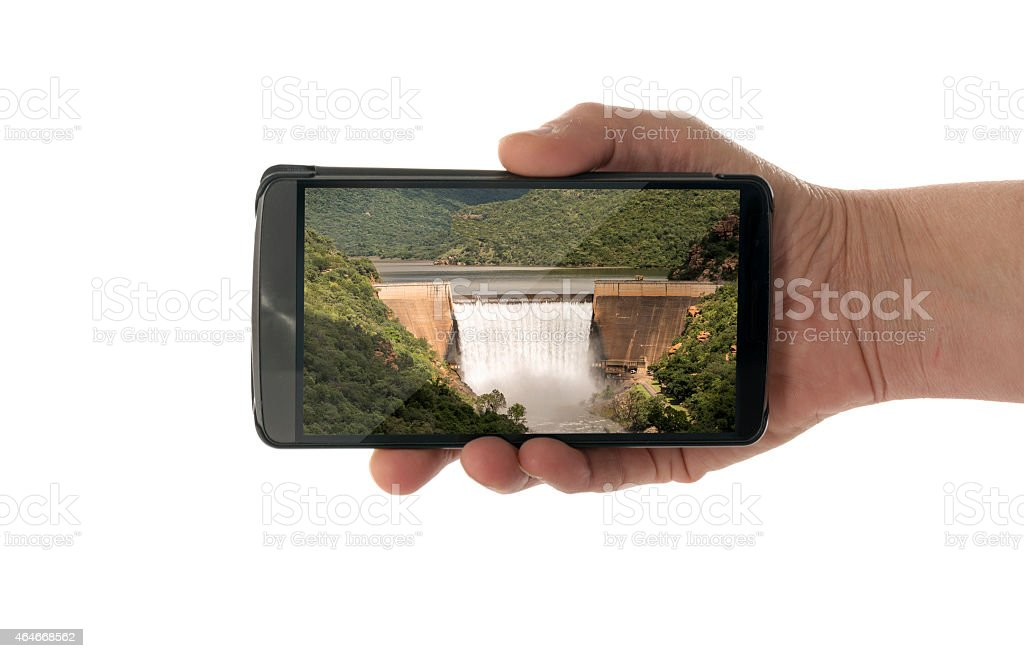 female hand with mobile phone waterfall stock photo