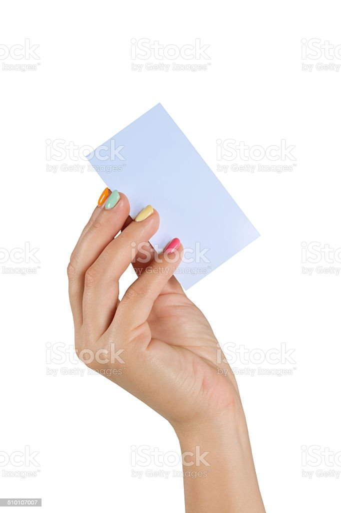 female hand with multicolored manicure holding a blank business card stock photo