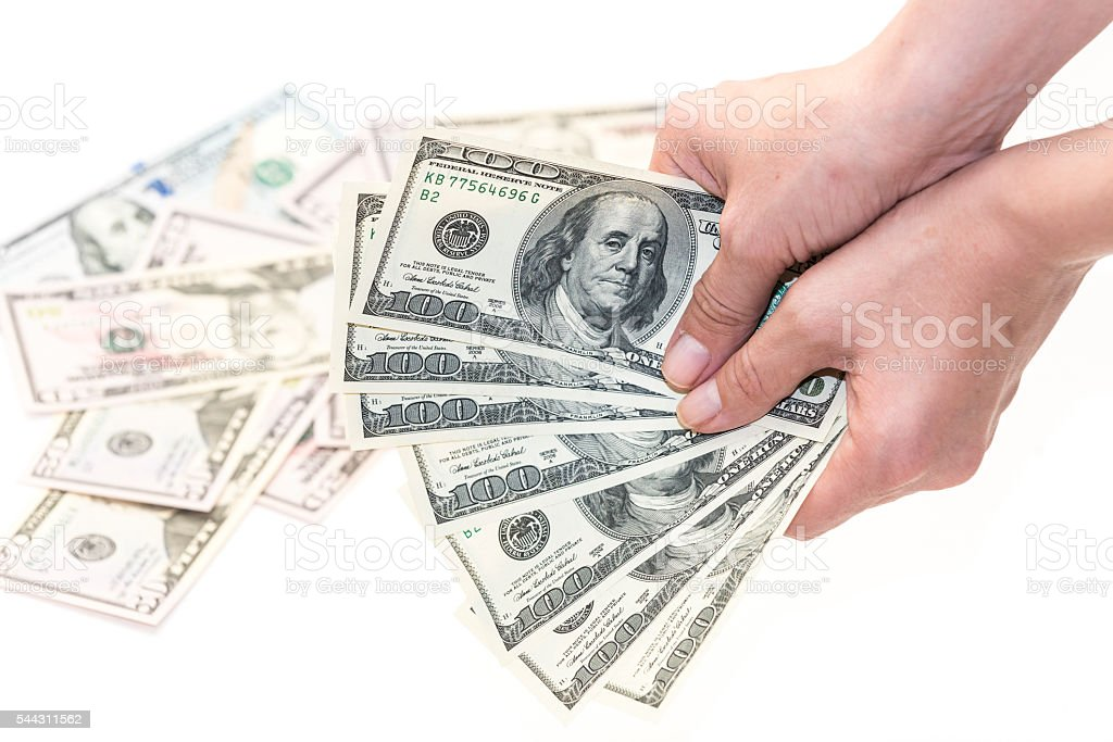 Female hand with one hundred  dollars banknotes stock photo