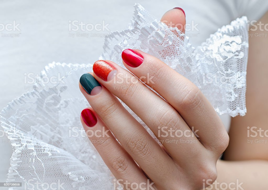 Female hand with red and green nail design stock photo