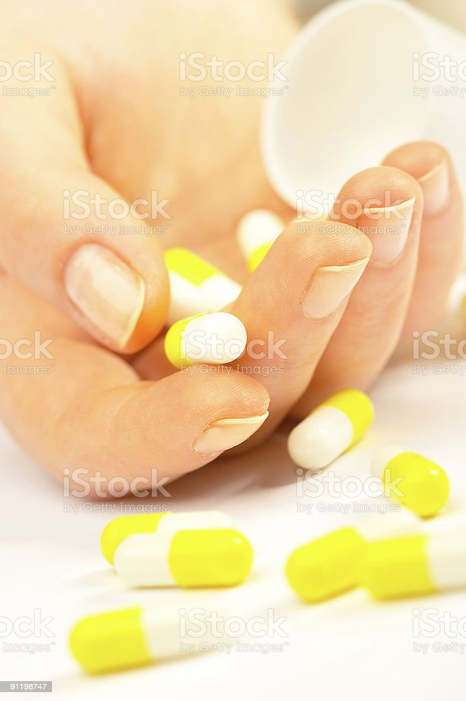Female hand with tablets. royalty-free stock photo