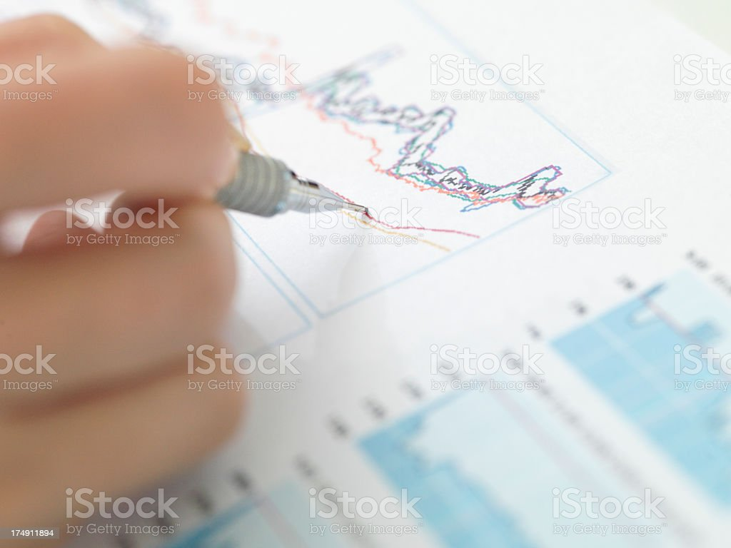 Female hand writing graph view from close range. royalty-free stock photo