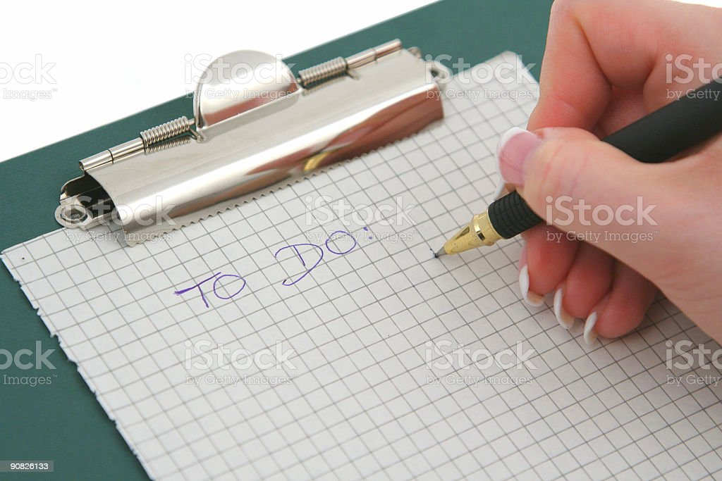 female hand writing TO DO list royalty-free stock photo