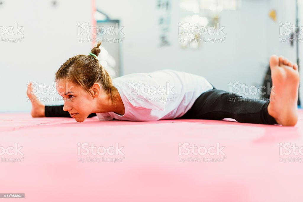 Female handicapped athlete stretching for training stock photo