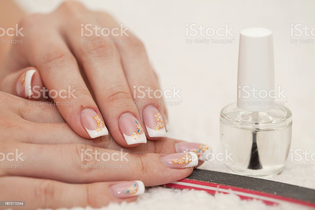 Female hands and manicure related objects in spa salon royalty-free stock photo