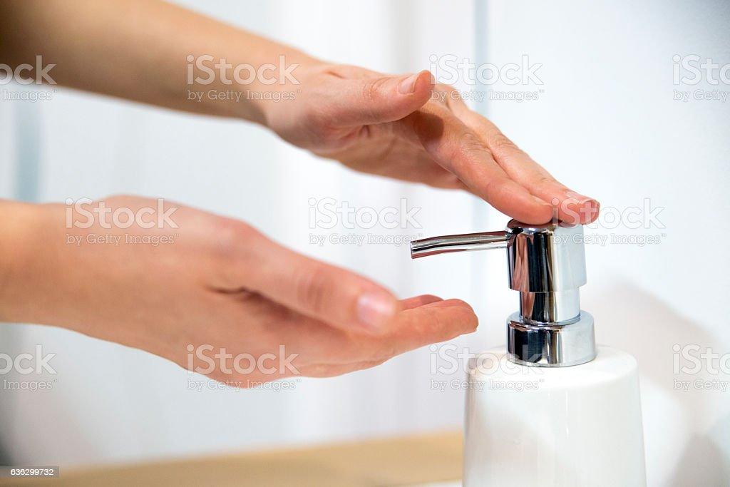 Female hands applying liquid soap close up stock photo