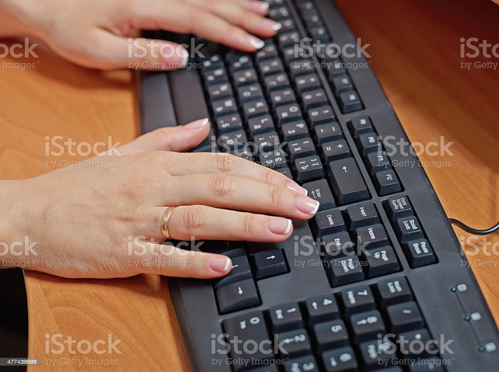 Female hands at keyboard stock photo