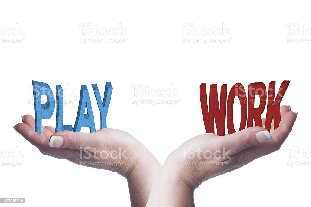 Female hands balancing work and play 3D words conceptual image royalty-free stock photo