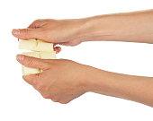 Female hands break bar of white chocolate isolated.