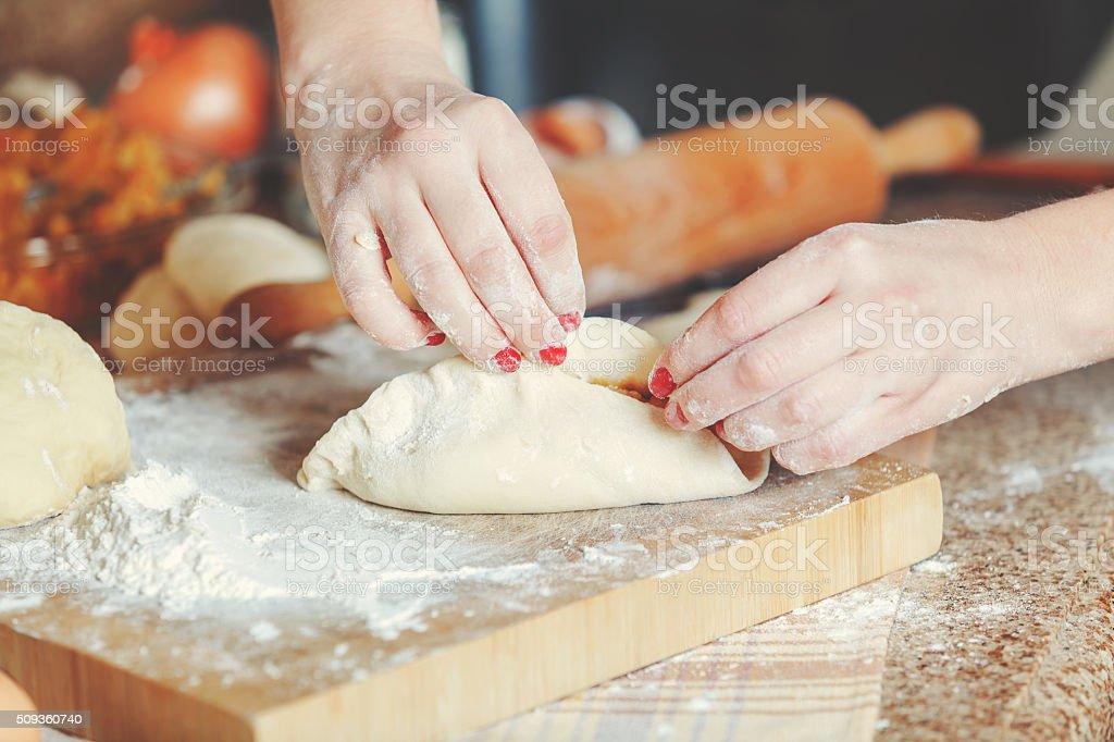 Female hands fasten halves patty stock photo