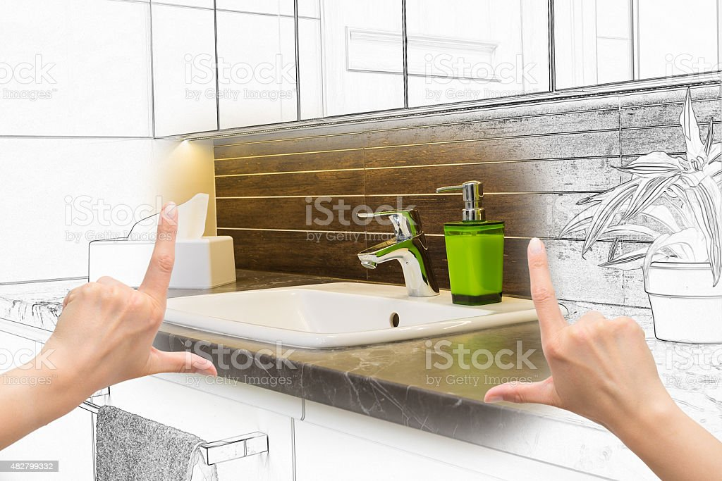 Female hands framing custom bathroom design. stock photo