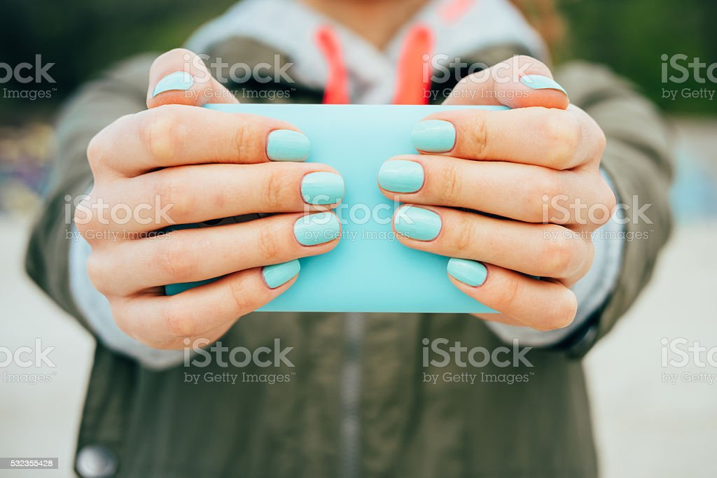 Female hands holding a mobile phone stock photo