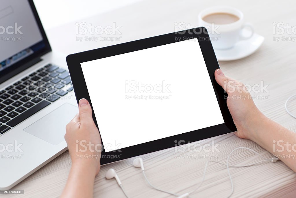 female hands holding a tablet with isolated screen stock photo