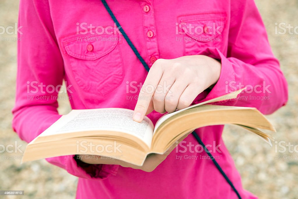 Female hands holding book stock photo