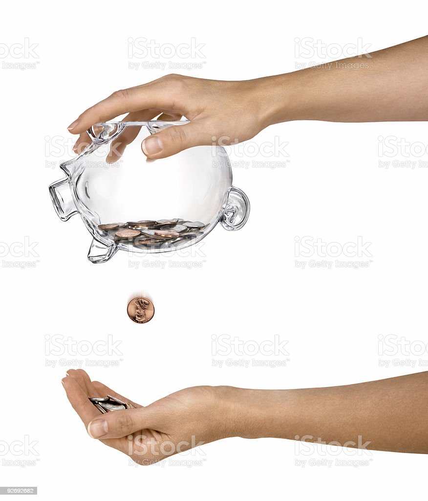 Female Hands Holding Clear Piggy Bank Shaking Out Coins Isolated stock photo