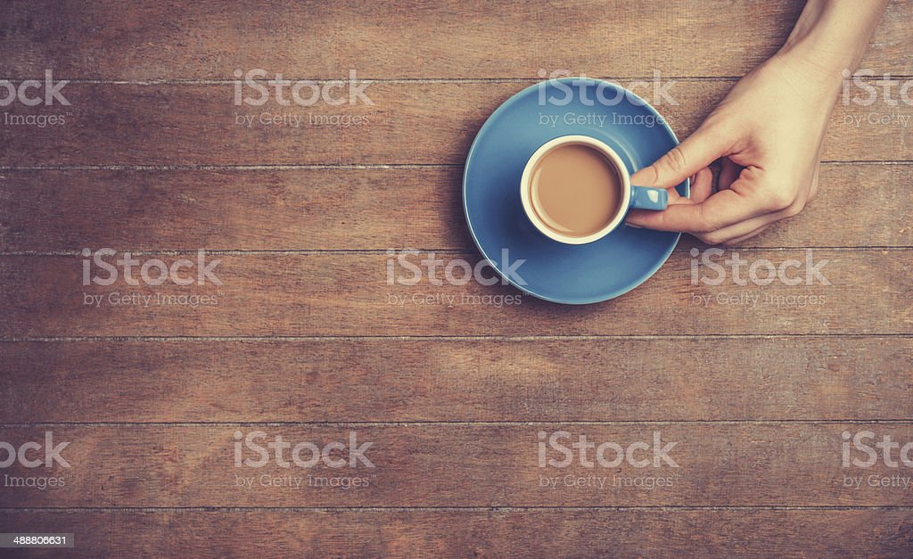 Female hands holding cup of coffee. stock photo