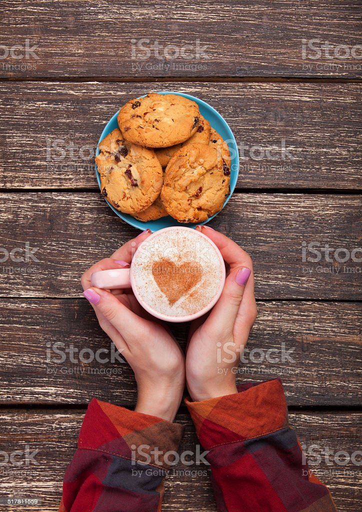 Female hands holding cup stock photo