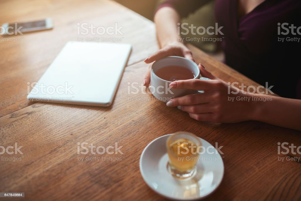 Female hands holding cup top view stock photo