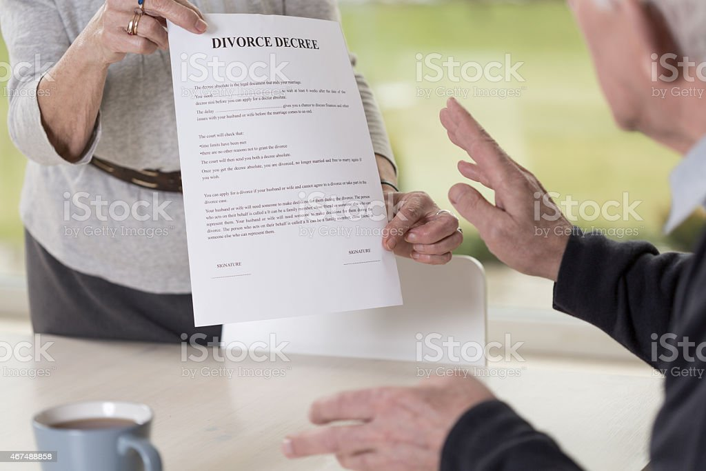 Female hands holding divorce paper stock photo