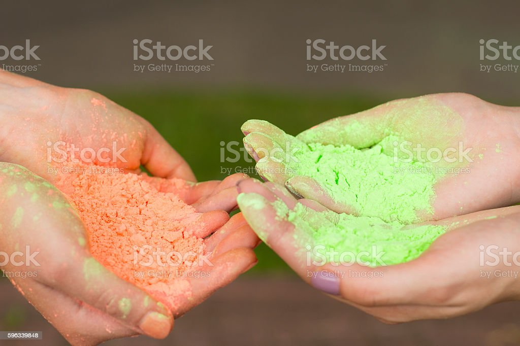 Female hands holding dry paint stock photo