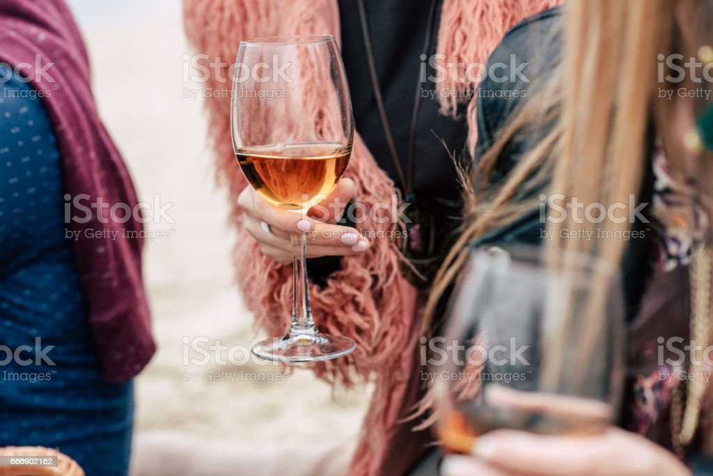 Female hands holding glasses with wine stock photo
