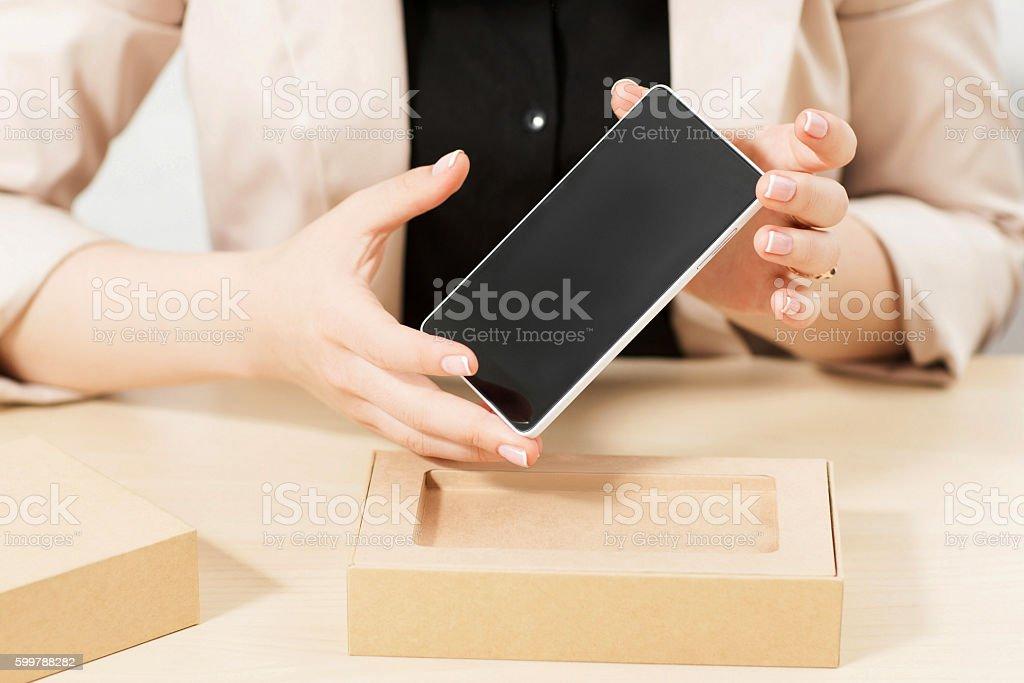 Female hands holding new smartphone stock photo