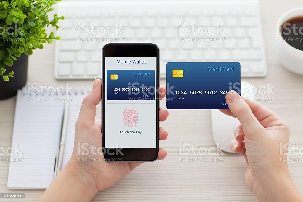 female hands holding phone with fingerprint for online shopping stock photo