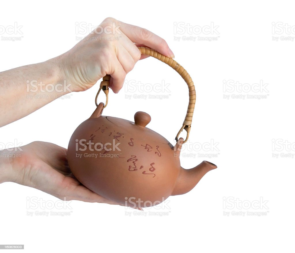Female hands holding teapot royalty-free stock photo