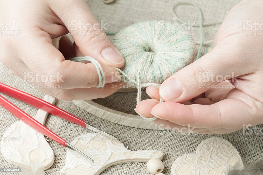 Female hands holding thread stock photo