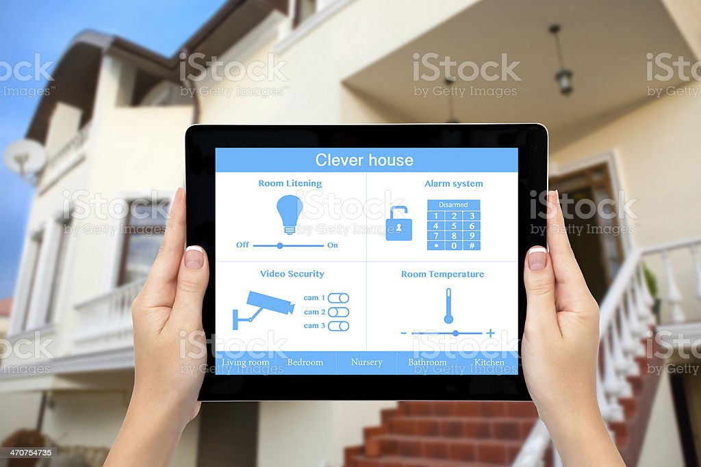 Female hands holding up a tablet with Clever House stock photo