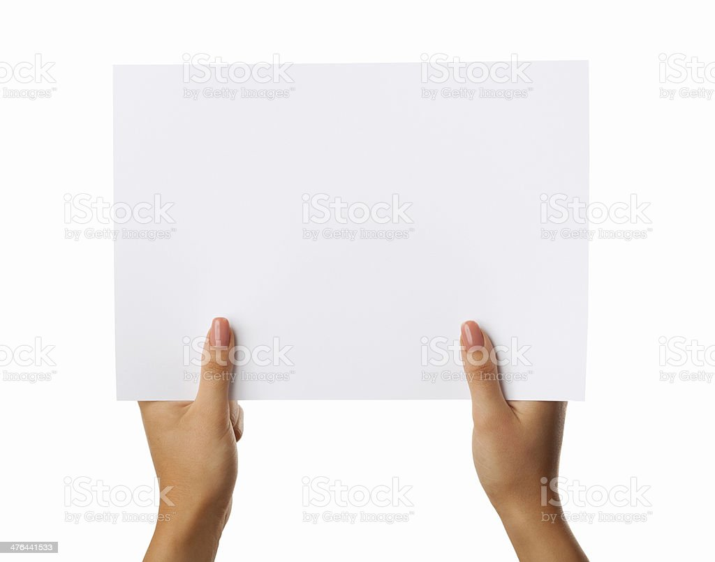 Female hands holding up blank page on white stock photo