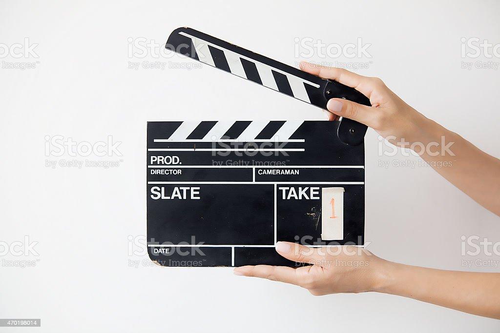 female hands holding wooden retro movie slate stock photo