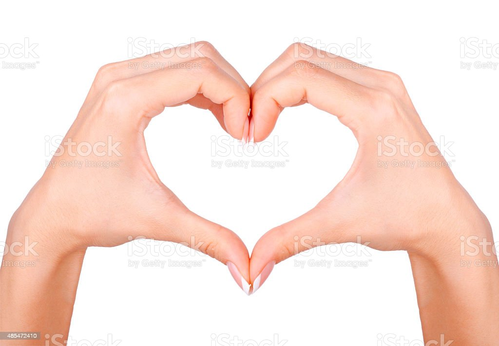 Female hands in the form of heart. stock photo