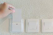 Female hands inserting hotel cardkey for lights