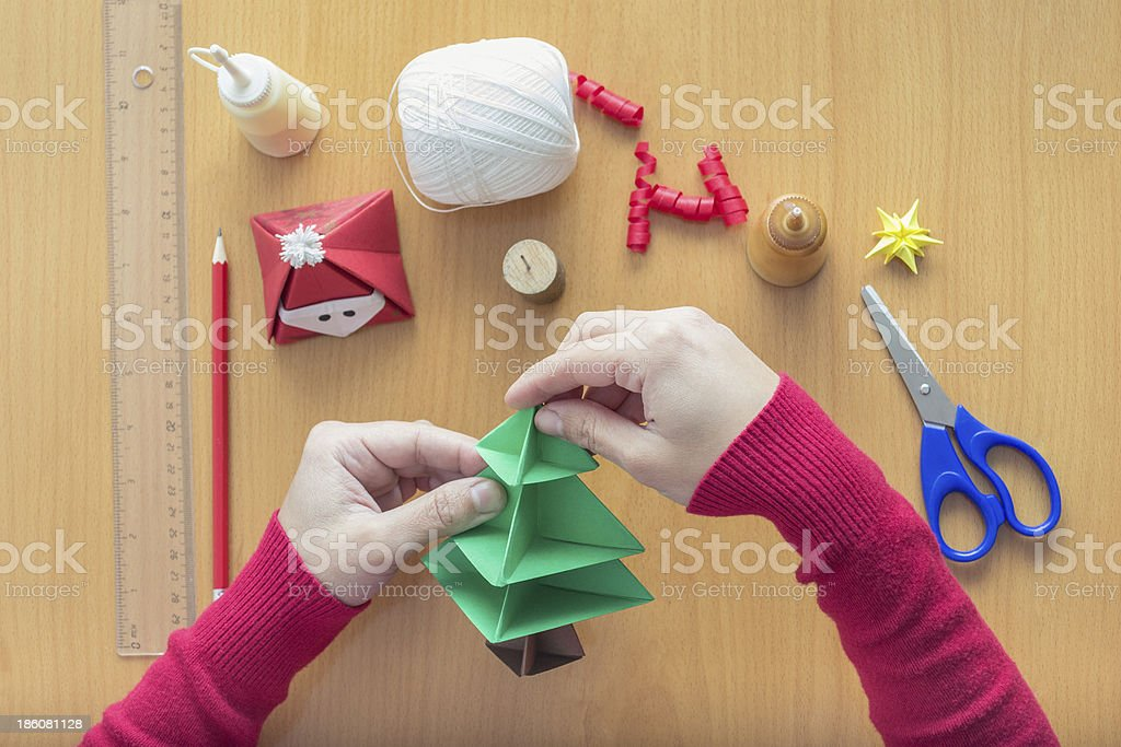Female hands making Christmas decorations stock photo