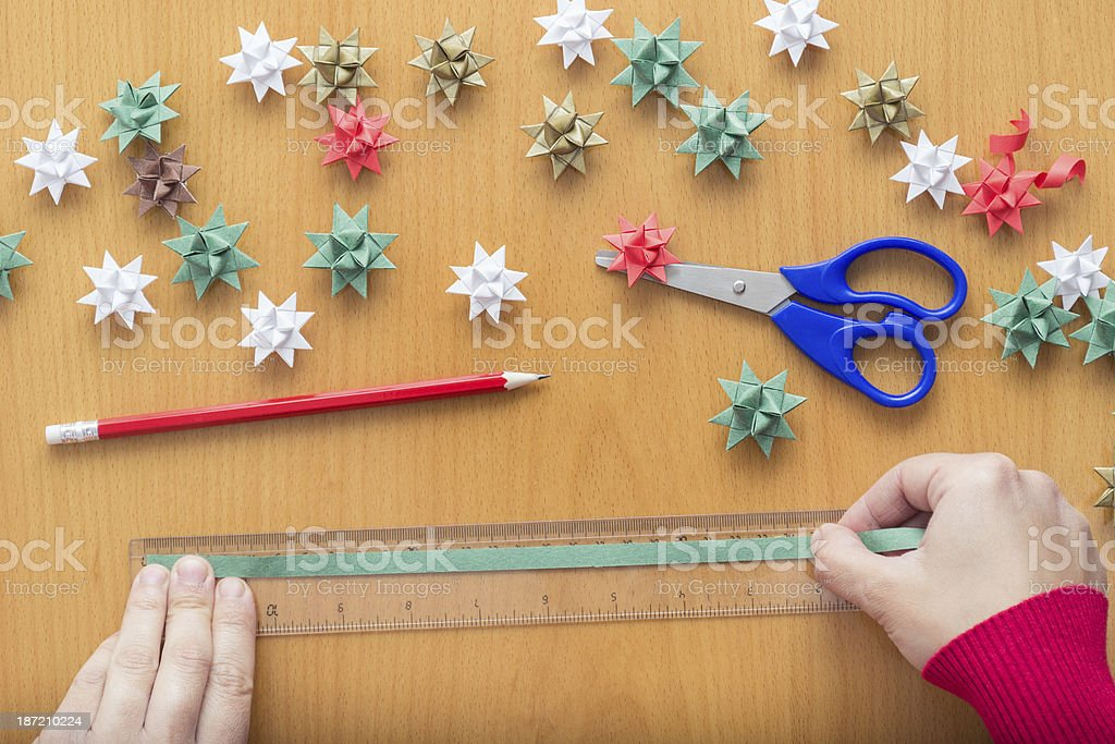 Female hands making Christmas decorations royalty-free stock photo