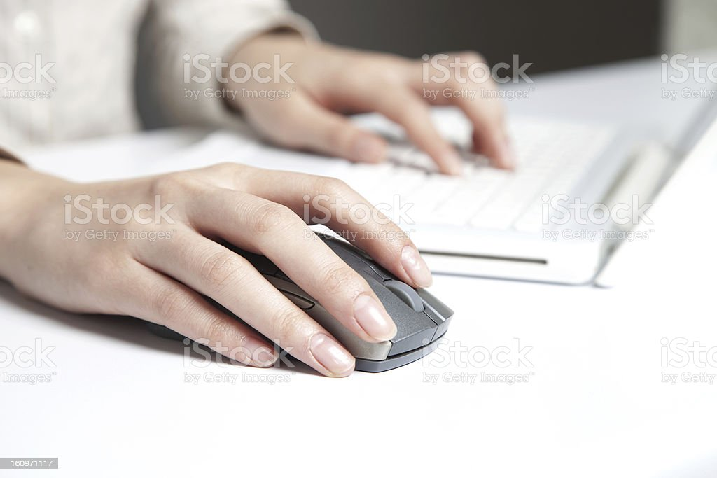 Female hands on a computer keyboard and mouse stock photo
